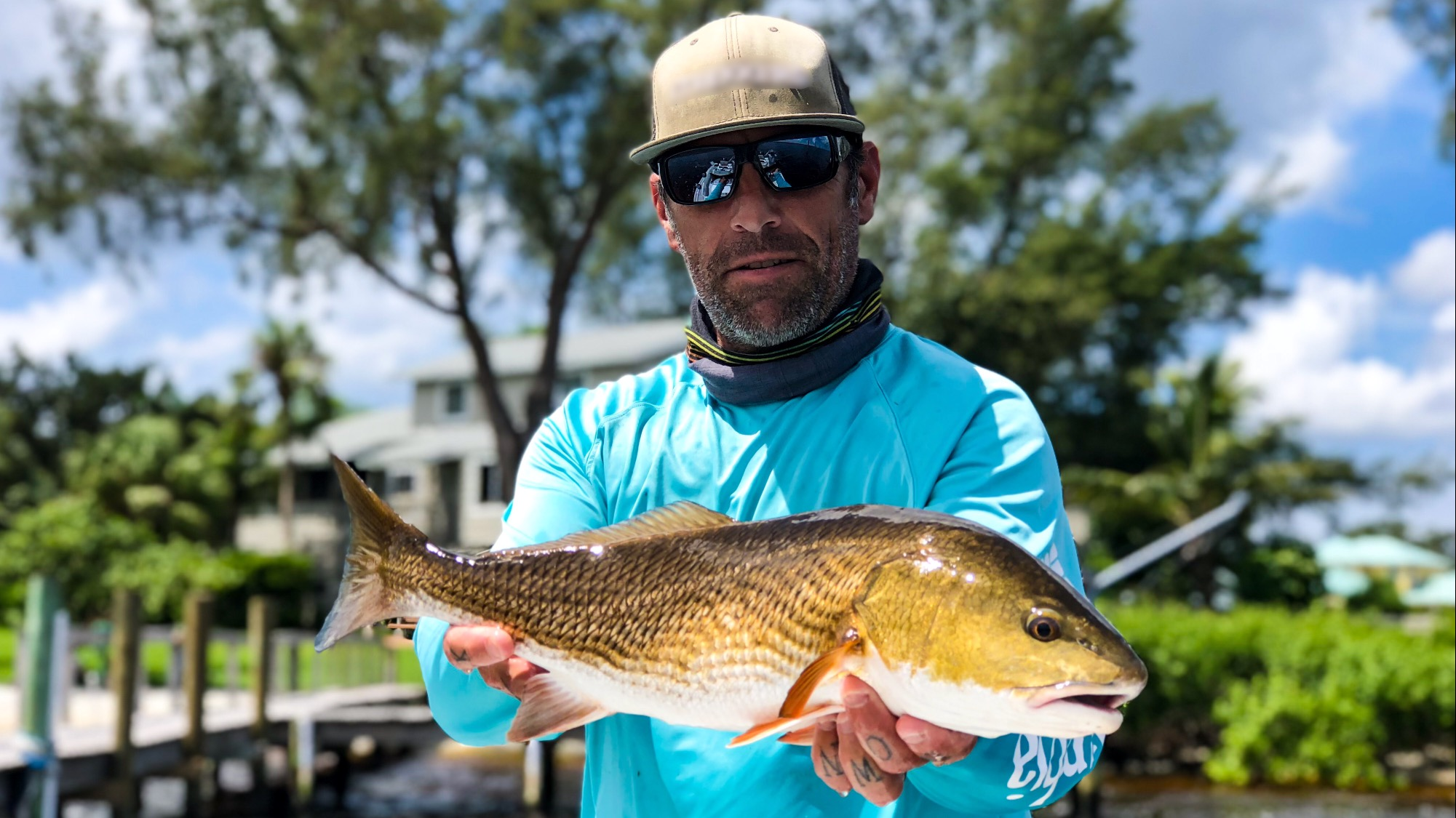a bradenton fishing guide holding a redfish he caught